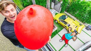 Video DROPPING 100LBS WATER BALLOON ON HER!! (GONE WRONG) MP3, 3GP, MP4, WEBM, AVI, FLV September 2019