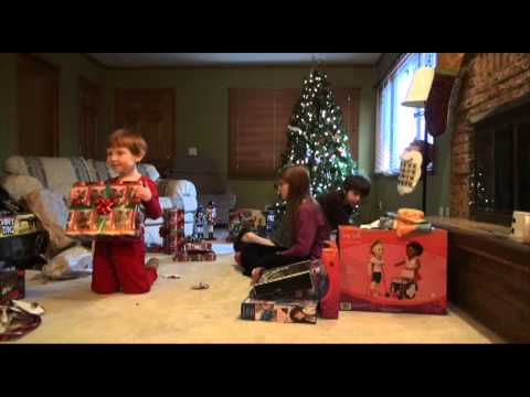 Funny Christmas Video - Paul lets one slip because he is so excited about what he got from Santa for Christmas. For those who just want to see the highlight it is at 1min and 11 sec...