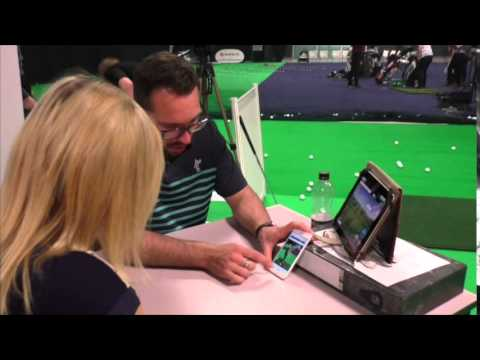 Peter Finch gives Emily Wood a golf lesson at Manchester Golf Show 2015