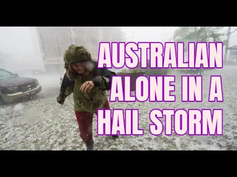 An Australian man gets stuck in the middle hailstorm. He's hilarious
