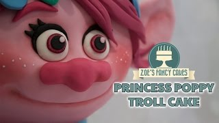 This tutorial will show you how to make a bright pink 3D Poppy Troll cake. I have had so many requests for this one that I thought I had best watch the film and create the cake . Hope you enjoy it. You can find links below to everything I have used. You can see more of my movie inspired cakes here - https://tinyurl.com/hhrdltr Tools and products used in this video - Renshaw's fondant White - http://amzn.to/1TCs62Z Renshaw's fondant Black - http://amzn.to/2lXT7BmCake Frame - http://amzn.to/2pcWqUVCake modelling tool -  https://www.facebook.com/commerce/products/1878762348816211/Craft mat - http://amzn.to/2dMKpl9 Rainbow Dust Strawberry Pink - http://amzn.to/2o9woRzSugarflair Pink - http://amzn.to/2paE35TSugarflair Fuchsia - http://amzn.to/2p0FKDASugarflair Dusky Pink - http://amzn.to/2p0GyrLSugarflair Extar White - http://amzn.to/2paoOKhBasic Victoria sponge cake recipe - Ingredients: 225g butter225g caster sugar4 eggs225g self-raising flour 1 tsp vanilla essenceMethod:Cream together the butter and sugar, then beat in the eggs and vanilla essence. Once smooth and creamy, fold in the flour.Pour in to a greased cake tin and bake in the oven at 180degrees for approximately 40 minutes, until golden brown and a knife comes out clean.Buttercream recipe - 600g icing sugar, sifted300g unsalted or salted butter, softenedoptional flavouringBeat the ingredients together.Ganache Recipe - 200 grams of Dark chocolate melted into 100 grams of double cream. To see more of my cakes and creations please visit my pages below-Facebook https://www.facebook.com/zoesfancycakes Twitter https://twitter.com/zoesfancycakesInstagram https://instagram.com/zoesfancycakes/Website http://www.zoesfancycakes.co.uk/You can also check out my online courses with 25% off below! :)Faces - https://www.udemy.com/how-to-make-sugar-craft-faces/?couponCode=YT25OFFRoses - https://www.udemy.com/how-to-make-sugar-craft-roses/?couponCode=YT25OFF