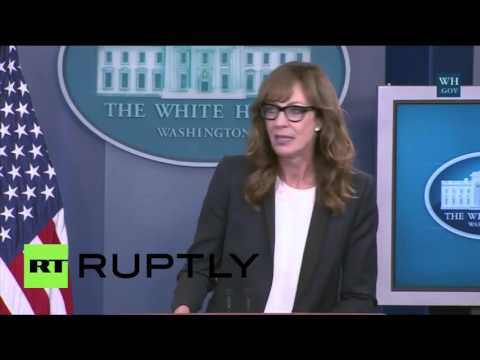 West Wing's Allison Janney appears at White House Press podium.