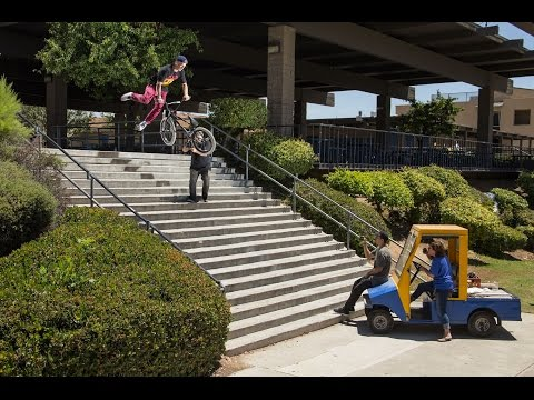 Security guard tries to stop bmxer from landing a trick down a lot of stairs.