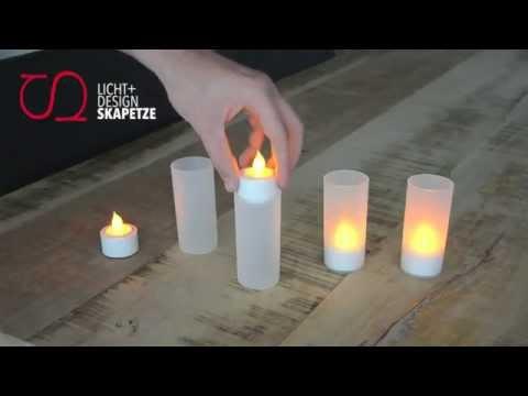 LED-Kerzen mit Flackereffekt / 4er Set mit Dockingstation