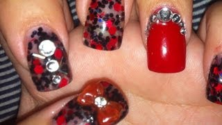 Hi guys! Hope you like this black and red acrylic nail design I did on myself. I used glitter mix, red acrylic, gem stones, acrylic bows to complete it. Than...