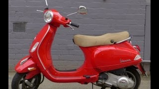 10. Vespa LX 150 ie red colour Scooter Motorcycle