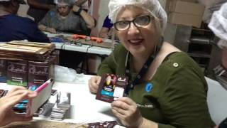 Packaging chocolate bars at a chocolate factory during a Fathom Impact Cruise to the  Dominican Repu