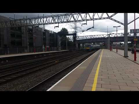 Stafford Railway Station 170206 GA seen passing the DFL working 5M70 on the 12th August 2017