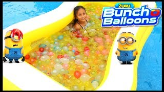"""1000 Bunch O Balloons Water Balloons Fight for Kids Despicable Me 3 Target Kid vs mom challenge Family Fun Activities Pretend playThank you Zuru Bunch O Balloons for sponsoring this video. All thoughts and opinions are my own. My experience may differ from yours. The URL for the contest website is: http://promo.family.ca/contests/bunch-o-balloons/ Contest runs from 10:00 a.m. Eastern Time (""""ET"""") June 19, 2017 to 11:59 p.m. ET July 30, 2017. These self-sealing water balloons are summers hottest toy. Fill over a hundred self-tying water balloons in sixty seconds. We had a family fun time throwing balloons at each other in the giant Kiddie Pool in our swimming pool! We had a pool inside a pool :) Great Kids video for children who loves playing games and toys outside. Just attach Battle Balloons to any hose, turn on the water and watch the balloons grow and grow! There's also the Filler Soaker, Launcher, Bubble Ball, Minions Water balloons, and more for an ultimate outdoor summer play! Product Info:1.       Bunch O Balloons 3 Pack:Fill and Tie 100 water balloons in less than 60 seconds with the original self-tying water balloons! With innovative O-Ring technology and Rapid Fill capabilities, say goodbye to the stress and mess of filling individual water balloons and say hello to never ending splash out loud fun! Simply connect, fill and make hundreds of water balloons with no hand-tying. Unleash summer super-fast with Bunch O Balloons!2.       Minions Bunch O Balloons 3 Pack:Combining ZURU Bunch O Balloons award winning technology with Universals Minions to bring to you the ultimate Minion mayhem item! Simply connect, fill and tie hundreds of water balloons and let the Minions mischief begin!3.       Bunch O Balloons LauncherBlast ZURU Bunch O Balloons spectacular distances with this all new Launcher, powered by X-SHOT. Throw water balloons up to 60ft with this light weight and  aerodynamic  launcher and blast the competition out of the water4.       Bunch O Balloons Fi"""