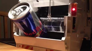 """Crushing a Red Bull can in my RC Norba RL35. These cans are actually very sturdy in the upper and lower """"ends"""", and did prove to be quite a challenge for my truck. The problem is that the """"ends"""" must be pushed through the narrow passage between the slide plate and the hopper floor. Still, with some packer manouvering, the can will be fairly effectively reduced in size."""