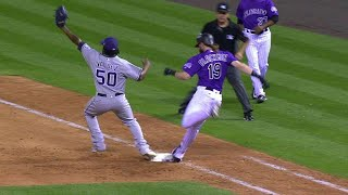 Wil Myers stays with a grounder long enough to flip to first in time to nab Charlie Blackmon and the call is confirmed on a review...