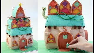"Hi everyone! Today I made Stella's Witch House. Thanks to King, the makers of BubbleWitch 3 Saga for sponsoring this video! Download here for free: http://to.king.com/CakeStyleNot only is it a super fun game, but her house makes the perfect witchy cake!Follow UsWEBSITEhttp://cake.style/FACEBOOKhttps://www.facebook.com/cakestyletvTWITTERhttps://twitter.com/Cake_StyleINSTAGRAMhttp://instagram.com/cakestyle_PINTERESThttp://www.pinterest.com/cakestyletv/Materials•  Four 9"" x 13"" slab cakes each made using one batch of my vanilla cake recipe - http://cake.style/2016/03/01/vanilla-cake/•  800g Sweet Buttercream - http://cake.style/2016/03/01/sweet-buttercream• 1 1/2 batches Modelling chocolate - http://cake.style/2016/04/30/modelling-chocolate/• Gel food colors• 14"" square cake board• Water• Sugar syrup• Small spatula - http://amzn.to/1Vtq19X• Mult ribbon cutter - http://amzn.to/1XDYSyo• Bread Knife - http://amzn.to/1qXhtew• Small rolling pin - http://amzn.to/1Slg8Ku• Large rolling pin - http://amzn.to/1YARC6x• Cornflour/ Cornstarch• Exacto knife - http://amzn.to/22BXAFk• Scraper - http://amzn.to/1Tc5ocs• Pizza cutter - http://amzn.to/1r5FyA4• Paint brush• Toothpick• Large rectangular cake board• Cardboard cake boards• Clear alcohol to mix (I used Vodka)• Boning tool• Ruler or tape measure• Wooden dowels• Conduit cutters• Floral wire• Star cookie cutter• Round cookie cuttersMusic - Nicolai Heidlas Music 'Pacific Sun''Real Ride''Sunday Holidays""by Nicolai Heidlas Music is licensed under a Creative Commons Licensehttps://soundcloud.com/nicolai-heidlas"