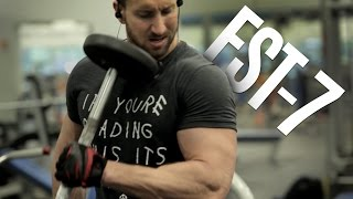 """Skinny guys, get more tips to gain weight here:http://www.weightgainblueprint.com/view/yt13zFST-7 training is a special type of training designed by Hamy Rambod who is the world renowned trainer to Jeremy Buendia and Phil Heath. (Both Mr. Olympia winners.)This type of training is awesome for naturally skinny guys because it will unleash some new gains and help you reach your genetic potential and overcome any muscle building plateaus that you are currently facing.It's very important to switch up your training routine if you want to continue building muscle mass year after year - and FST-7 training is my favorite.In today's video I decided to blast the biceps and triceps with Fascia Stretch training. The science behind this training is that it makes the fascia tissue on top of the muscle """"more flexible and pliable"""" which helps the muscle to grow bigger and faster.We all have our genetic limitations with muscle growth and this is one of the unique tricks that helps guys overcome these genetic limitations very easily.I put together this effective FST-7 biceps and triceps workout so you can get bigger arms.I encourage you to do this workout 1-2 times per week to bring up your arms.What do you think of this type of training? Let me know in the comments below if you want me to cover any other muscle groups!See the full blog post here: http://www.weightgainnetwork.com/workouts/fst-7-style-arm-workout-biceps-and-triceps-fascial-stretch-training.phpThe 7 Hardgainer Mistakes That Are Keeping You Skinny:★ http://www.weightgainblueprint.com/view/yt13zComplete Weight Gain Program:★ http://www.WeightGainBlueprint.com[ GET OUR LATEST VIDEOS ]Click here to subscribe:► http://bit.ly/Subscribe-To-WGNCheck out the rest of the videos:https://www.youtube.com/user/WeightGainNetwork/videos[ FIND US ONLINE ]Website:http://www.WeightGainNetwork.comFacebook:https://web.facebook.com/weightgainnetwork/Twitter:http://www.twitter.com/WeightGainNetGoogle+:https://plus.google.com/+WeightGainNetwor"""