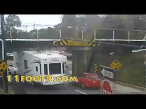 Camper tries to sneak up on the 11foot8 bridge