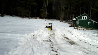 2. Cub Cadet Big Country UTV Plowing Snow