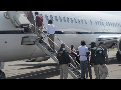 Eight Alleged Scammers Extradited Under Heavy Security (видео)