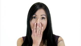 Purchase this clip here: (http://www.StockFootage.com/2947). A close up shot on white of an Asian girl with a surprised look on...