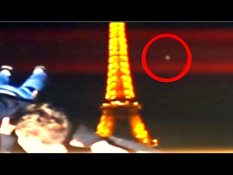 France - In this video a young girl was recording group of friends people having a good time at the famous Eiffel Tower. In the background along the horizon, you can see three UFOs flying to frame....
