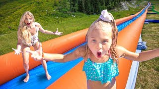Video WE TURNED OUR BACKYARD INTO THE WORLD'S LARGEST WATERSLIDE MP3, 3GP, MP4, WEBM, AVI, FLV September 2019