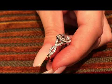 Platinum ring with 2.5 Cubic Zirconia Cushion Cut Halo Style Ring