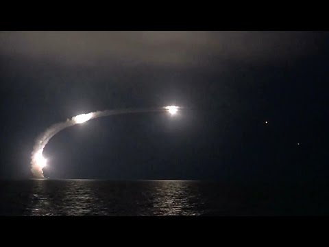 Russian ship launching a volley of missiles.