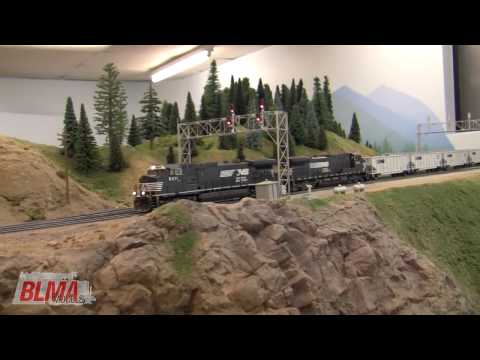 NS - Visit Tim Dickinson's HO Scale model train layout for an unusual sight - Norfolk Southern locomotives and TopGon coal cars traversing the line between Spokan...