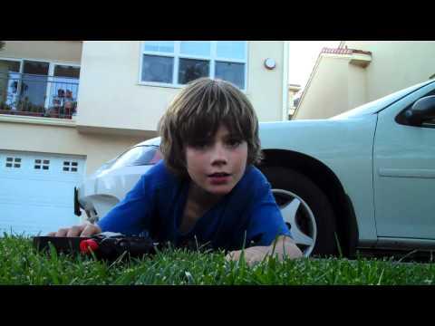 Kid breaks friend's camera with an Airsoft gun