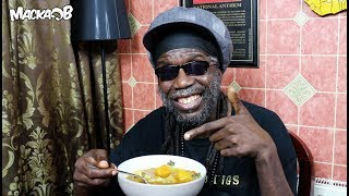Wha Me Eat Wednesday'Rasta Vegan Ital Soup Recipe (Ital Sip)' with subtitlesFollow Macka B:https://www.facebook.com/OfficialMackaBhttps://www.instagram.com/officialmackabhttps://twitter.com/mackab http://www.mackab.comCucumba & Wha Me Eat T-Shirts Available at www.mackab.comLyrics:ital sip ok here's the starterGet a big pot with two pints of waterPeel some sweet potato and yamPumpkin or squash and put them in the panMek it boil for a little bit then mek it simmerTime for the vegetables dem fi go innaPeel the cho cho cut it inna quarterDice the cho cho and the green pepperChop up the callaloo the cabbage whateverThe carrot the veg what you like be cleverPut in the Scallion and the garlicPut in the tomatice and scotch bonnetThat's pepper put it in whole entireCause if you cut it up it could be hot like fireYou can add Bayleaf you can add thymeUse natural seasoning's you like,me no mindLet all the ingredients combineMek it simmer simmer down timeWhen everything cook could be 40 minuteThere you have it ,Ital SipAnd this is itYes IyahRecipe:YamSweet PotatoPumpkinCallalooSmall cabbage ThymeCho ChoGreen pepperGarlicTomatoSpring onionWater BayleafScotch bonnetSquash Carrot Strictly speaking Ital sip is made without salt but if you must then please use Himalayan or Celtic sea salt