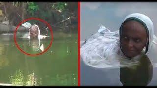 ШОК! В Индии женщина сидит в озере уже 20 лет  Зачем ей это надо