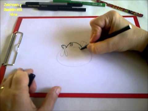 Zeichnen lernen für Anfänger.Einen lustigen Hasen auf dem Osterei malen.