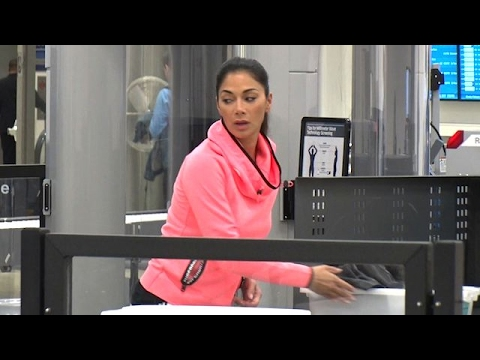 Pussycat Doll Nicole Scherzinger Pretty In Pink At LAX