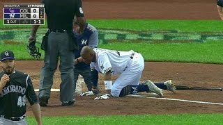 COL@MIL: Broxton exits after being HPB in the face