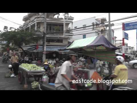 walking in to Cho trung tam market Soc Trang city Vietnam