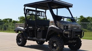 9. 2014 Kawasaki Mule 4010 Trans Camo Loaded Stereo, LED lighting and more
