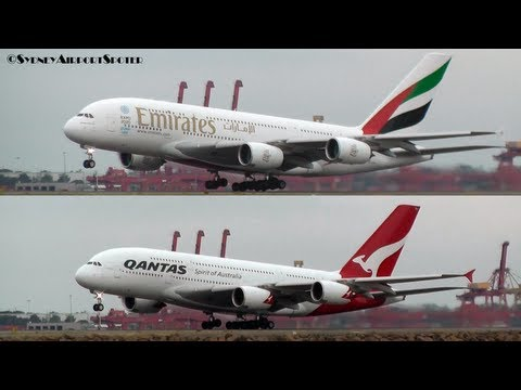 Emirates - A Qantas A380 (VH-OQJ) and an Emirates A380 (A6-EDY) take off at Sydney Airport together for the flyover in the City. This was to mark the start of the Qanta...