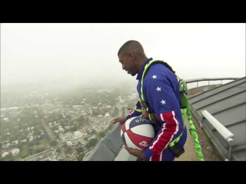 The Harlem Globetrotters climbed to the top of the Tower of America and made a 583-foot shot!