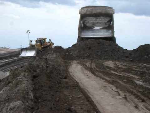 haul truck crash - The huge D-10 Cat is dwarfed by the 797 haul truck dumping overburden on a fill site.