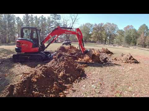 Kubota Mini Excavator Digging Out Stumps