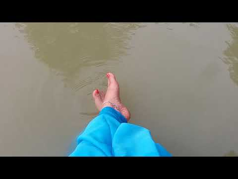 Indian Beautiful Feet Dangling In The Water
