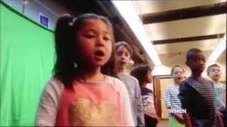 """Elizabeth South sings \""""Let It Go\"""" with her Durham Academy students on WNCN news"""