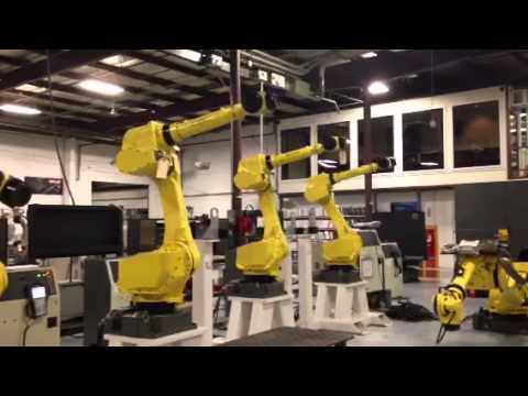 Three FANUC M-710iC Robots dancing