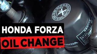9. 2015 Honda Forza Oil Change