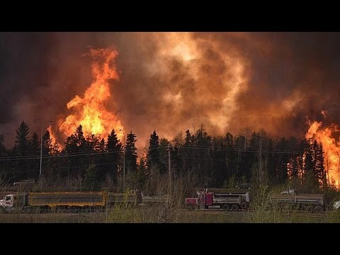 80,000 flee as inferno threatens Canadian oil hub