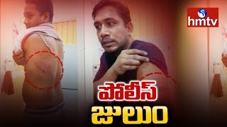 SI Lingamurthy Brutally Beats Lorry Driver In Rajanna Sircilla District