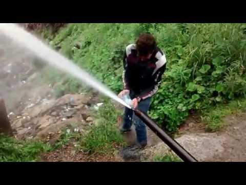Filling a Bottle with Kazakh Spring Water