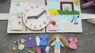 Книжка-домик для девочки. Содержит часы и куколку, учит определять время и распорядок дня.
