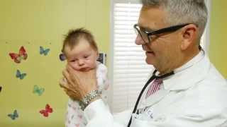 How To Calm A Crying Baby - Dr. Robert Hamilton Demonstrates