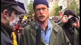 """""""Big Rattle In Seattle"""" by Si Mitchell. First of three movies from the """"Guerrillavision"""" series covering the WTO protests which took place in Seattle 1999.This channel: http://anarchi.st"""