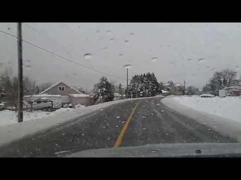 Snow piles - freezing rain - ice on walkways and road