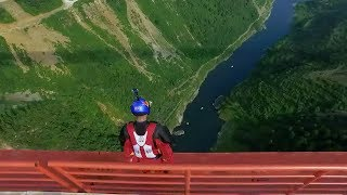 Following wingsuit jumper Zhang Shupeng's jump off Qingshui River Bridge in Wengan County, southwest China's Guizhou Province, the bridge and the area have been brought into the global spotlight. Opened just eight months ago, Qingshui River Bridge is the world's fifth highest bridge and the world's third highest suspension bridge. Subscribe to us on YouTube: https://goo.gl/lP12gADownload our APP on Apple Store (iOS): https://itunes.apple.com/us/app/cctvnews-app/id922456579?l=zh&ls=1&mt=8Download our APP on Google Play (Android): https://play.google.com/store/apps/details?id=com.imib.cctvFollow us on:Facebook: https://www.facebook.com/ChinaGlobalTVNetwork/Instagram: https://www.instagram.com/cgtn/?hl=zh-cnTwitter: https://twitter.com/CGTNOfficialPinterest: https://www.pinterest.com/CGTNOfficial/Tumblr: http://cctvnews.tumblr.com/Weibo: http://weibo.com/cctvnewsbeijing